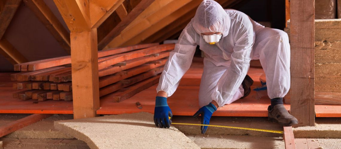 Man installs new insulation after squirrels in the attic
